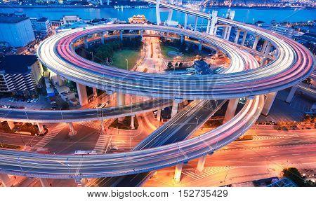 Spiral bridge in Shanghai Huangpu River on the bird's eye view of the beautiful night view