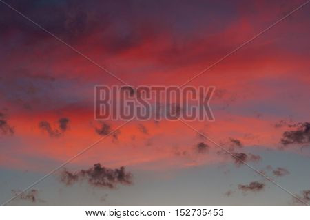 pink clouds on the sunset sky background pattern