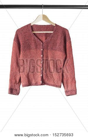 Terracotta knitted cardigan on wooden clothes rack isolated over white