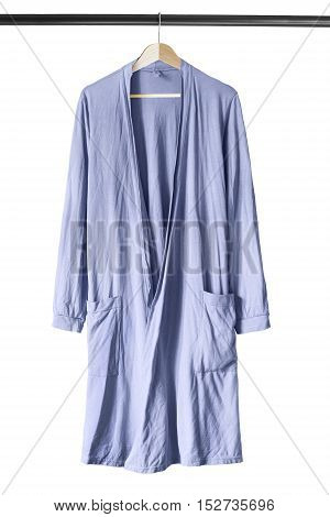 Blue cotton bathrobe on wooden clothes rack isolated over white