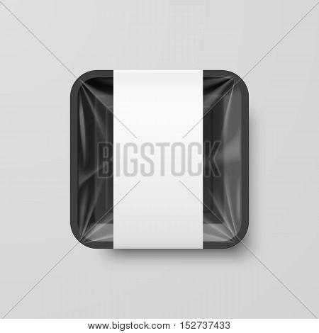 Empty Black Plastic Food Square Container with Label on Gray Background