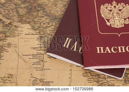 Two Russian Passports on map close up