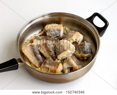 Fried fish for a nourishing lunch in a frying pan