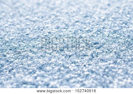 Glittering blue snow texture macro, shallow depth of field
