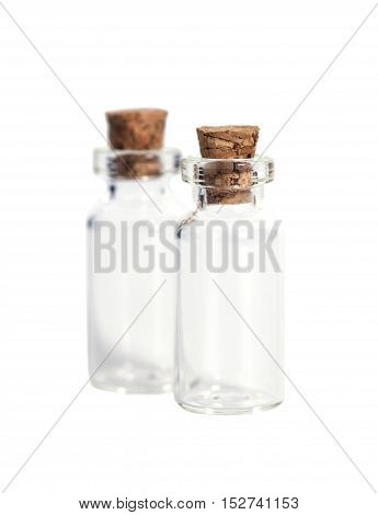 Glass bottles with cork cover isolated on white