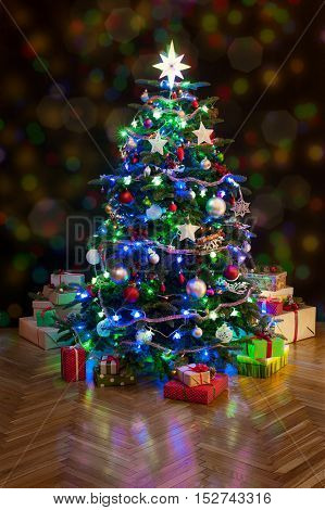 Christmas tree with gifts on dark glowing background at home