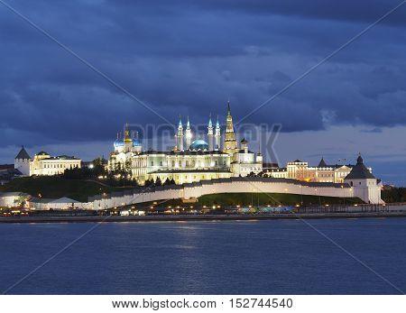 Kazan Kremlin illuminated by backlight in the evening twilight.