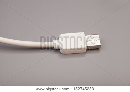 USB cable isolated on a gray background