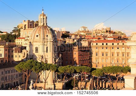 Domus church in Roma, Italy, at sunset with blue sky
