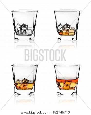 Glass of scotch whiskey and ice isolated on white background