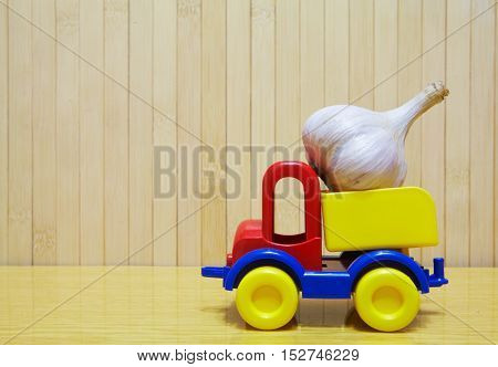 Toy Plastic Car With Garlic