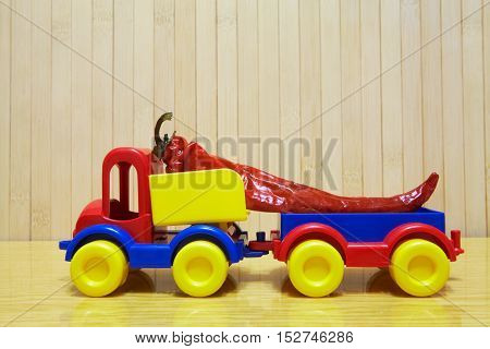 Toy Plastic Car With Red Pepper