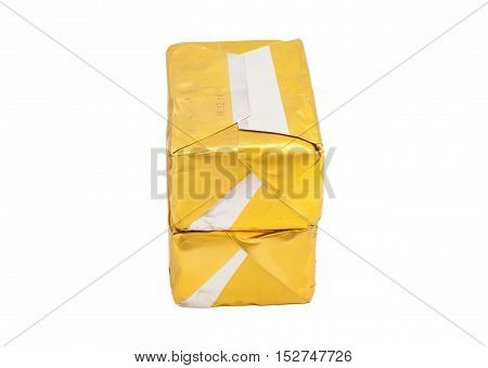wrapped butter sticks on a white background