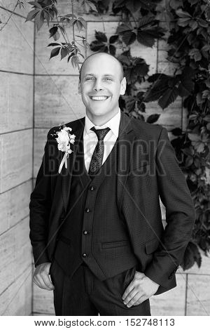 Happy man in a summer wedding day