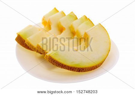 Ripe fresh cantaloupe slices on white plate