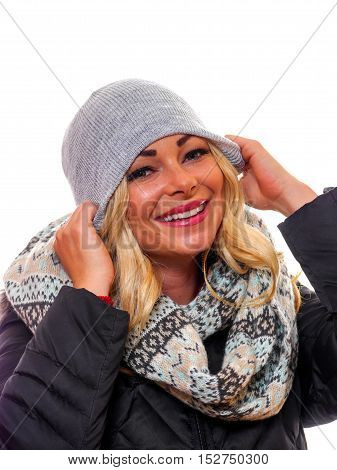 Image of a happy laughing blond woman dressed for winter.