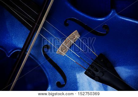 Detail of a violin with blue glitter varnish music instrument background selected focus