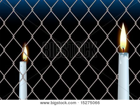 wire fence seperating two wax candle showing hope and peace