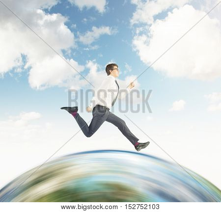 Side view of businessman in glasses running on huge globe. Concept of international business. Mock up. Toned image.