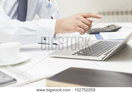 Man's Finger Pointing At His Laptop Screen