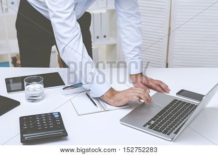 Standing Businessman Typing