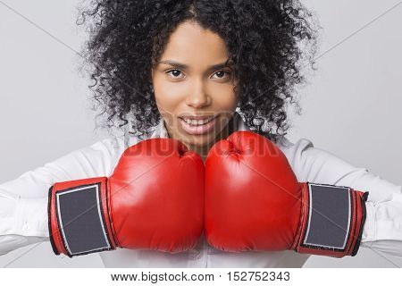 Smiling African American Girl With Red Boxing Gloves