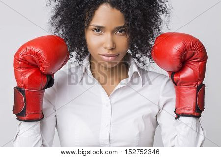 Centered African American Girl With Red Boxing Gloves Wearing Formal Clothes And Looking At The View