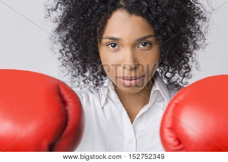 Determined African American Girl With Boxing Gloves