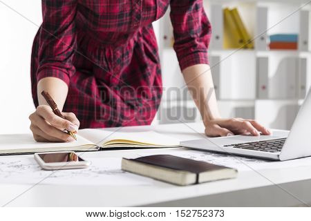 Close Up Of Woman In Red Checkered Dress Working With Documents