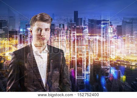 Portrait of young businessman on his phone standing against large cityscape at night. Double exposure. Toned image