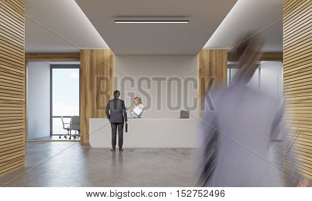 Woman And Two Men In Company Corridor