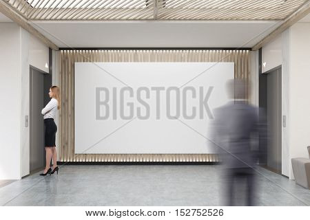 People And Large Horizontal Poster In Office Lobby