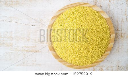 Couscous on wooden plate horizontal selective focus
