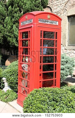 The red telephone box a telephone kiosk for a public telephone