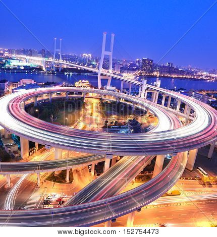 Spiral Bridge In Shanghai Huangpu River On The Bird's Eye View Of The Night