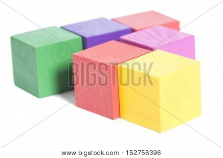 multicolor wooden bricks stack isolated white background