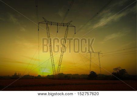 The V font Power transmission towers at sunrise