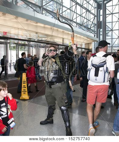 NEW YORK NEW YORK - OCTOBER 9: Man wearing Green Arrow costume at NY Comic Con at Jacob K. Javits convention center. Taken October 9 2016 in New York.