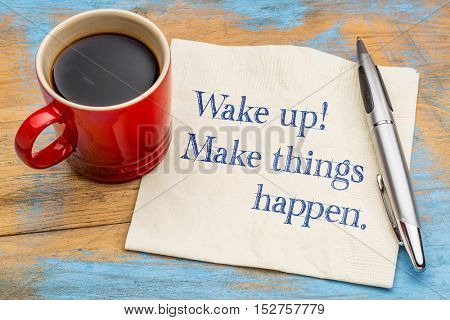 Wake up, make things happen - handwriting on a napkin with a cup of coffee