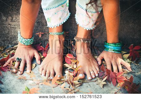 closeup of woman hands and feet practice yoga extension outdoor