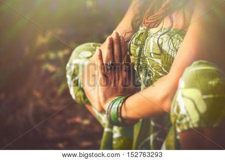 closeup of woman hands  in yoga position outdoor shot