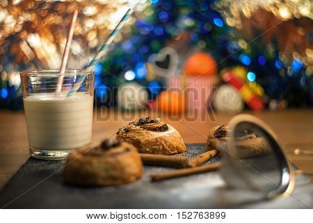 biscuits with glass of milk on black stone shiny background