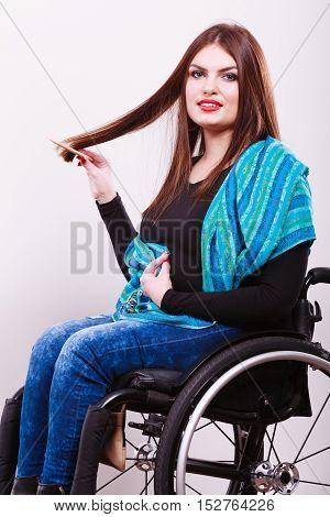 Disabled Girl Doing Her Hair.