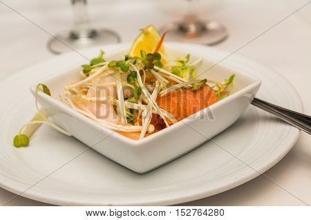 Salmon and Shrimp Appetizer on white plate
