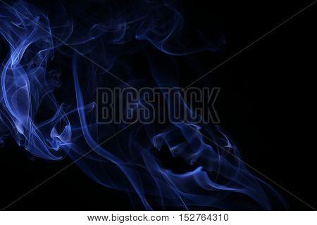 Abstract blue smoke on black background , movement of smoke