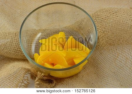 Rinsed canned peach slices in glass bowl