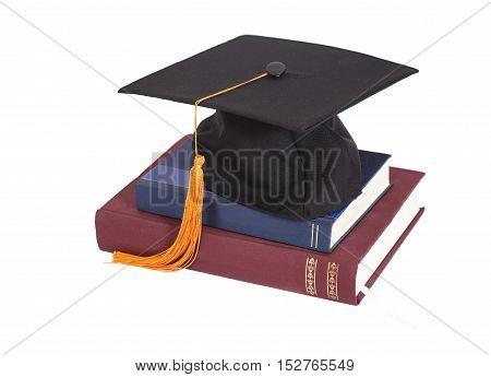 Graduation Cap On stuck of Books isolated