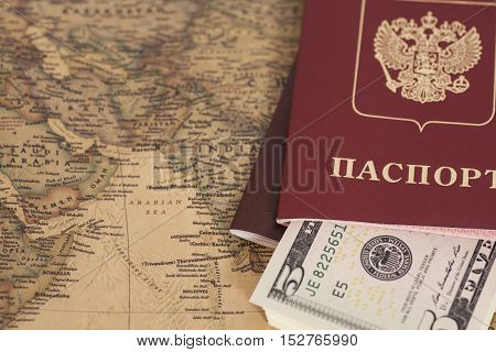 Russian International passports with dollars on the world map
