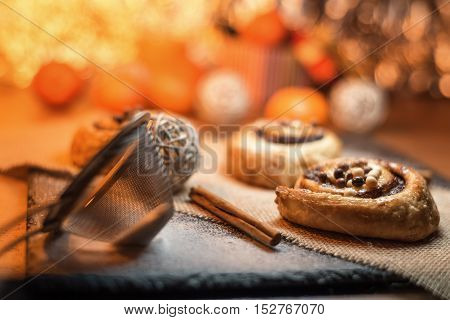 biscuits on black stone shiny background orange light