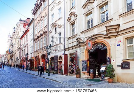 PRAGUE, CZECH REPUBLIC - DEC 23, 2014 : Tourists on foot Street in old town PRAGUE in Czech Republic